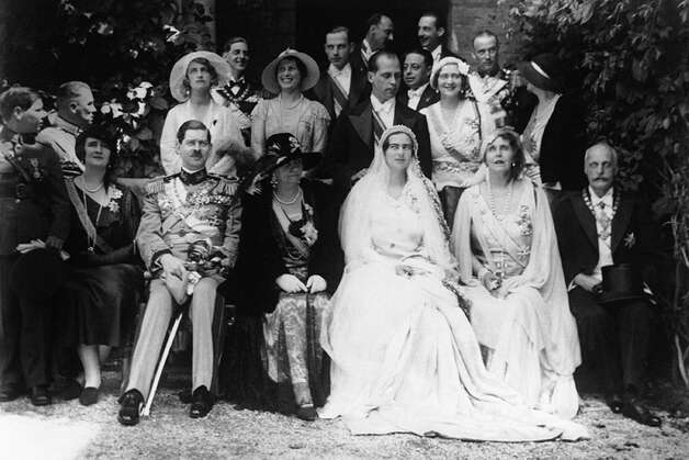 The wedding group at Peles Castle near Sinaia in the Carpathian Mountains of Romania poses on July 26, 1931. Front row, left to right are: Prince Michael, Ex-Queen Elizabeth of Greece, King Carol II of Romania, Archduchess Leopold Salvator Infanta Blanca de Castilla de Borbon, the bride Princess Ileana Hohenzollern-Sigmaringen, Queen Marie (Saxe-Coburg and Gotha) of Romania (mother of bride) and Archduke Leopold Salvator of Austria, Prince of Tuscany, (father of bridegroom). Second row: Archduchess Marguerite, sister of bridegroom, Prince Nicholas of Romania, Princess Kira of Russia, bridegroom Archduke Anton Habsburg-Lothringen and Queen Marie of Yugoslavia (sister of bride). (AP Photo)