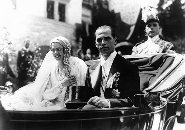 Princess Ileana Hohenzollern-Sigmaringen of Romania and her bridegroom Archduke Anton Habsburg-Lothringen leave the Peles Castle near Sinaia in the Carpathian Mountains of Romania in a carriage after their wedding on Sunday, July 26, 1931. (AP Photo)