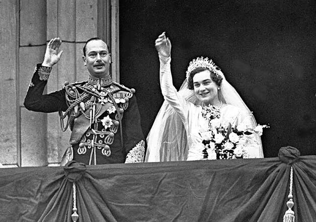 Britain's Duke and Duchess of Gloucester wave to the huge crowd that has gathered outside Buckingham Palace, London, after their wedding, Nov. 6, 1935. (AP Photo)