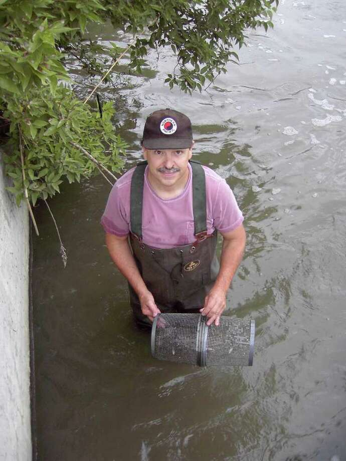 "Dr. Alan Kolok, a member of the Greenwich High School Class of 1974 and an environmental scientist within the University of Nebraska system, has recruited more than 50 ""citizen scientists"" to collect water samples along the banks of Nebraska's Elkhorn River Basin on Saturday, April 23, 2011.  Kolok said the inexpensive technique could advance the study of how Atrazine, the nation's most commonly used herbicide, travels through a waterway. Photo: Contributed Photo / Greenwich Time Contributed"