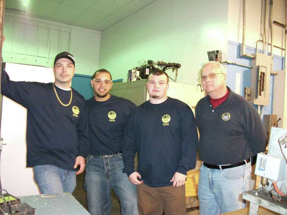 Left to right in an HVAC class are Leo McHugh and Jesus Burgos of Waterbury, Don Tozzo of Wallingford, and instructor Bill McDermott of Southbury. Photo: Nancy DeFelice/Contributed Photo, Contributed Photo