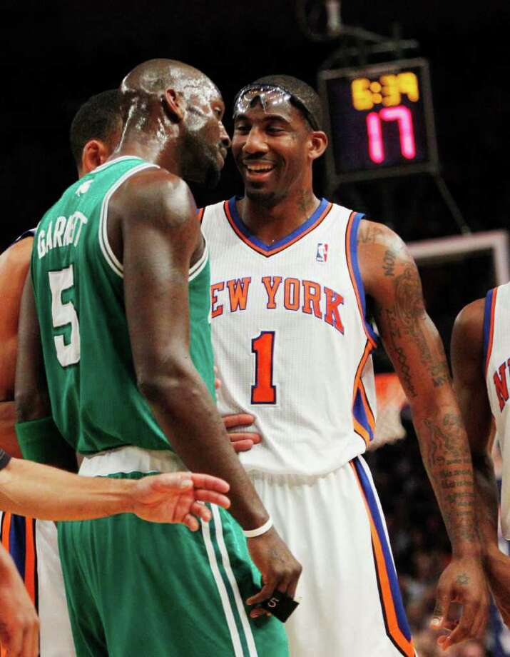Boston Celtics' Kevin Garnett (5) exchanges words with New York Knicks' Amare Stoudemire (1) during the first half of Game 3 of a first-round NBA basketball playoff series Friday, April 22, 2011, in New York.  (AP Photo/Frank Franklin II) Photo: Frank Franklin II