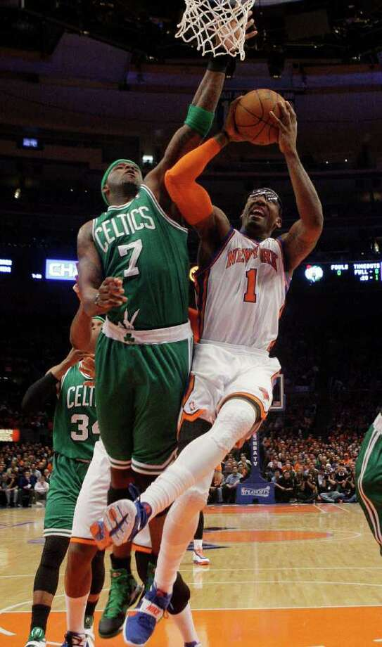 New York Knicks' Amare Stoudemire (1) drives past Boston Celtics' Jermaine O'Neal (7) during the first half of Game 3 of a first-round NBA basketball playoff series Friday, April 22, 2011, in New York.  (AP Photo/Frank Franklin II) Photo: Frank Franklin II