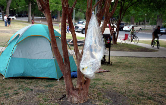 A recycling bag hangs from a tree on April 22, 2011, at Brackenridge Park as people camp for the Easter weekend.