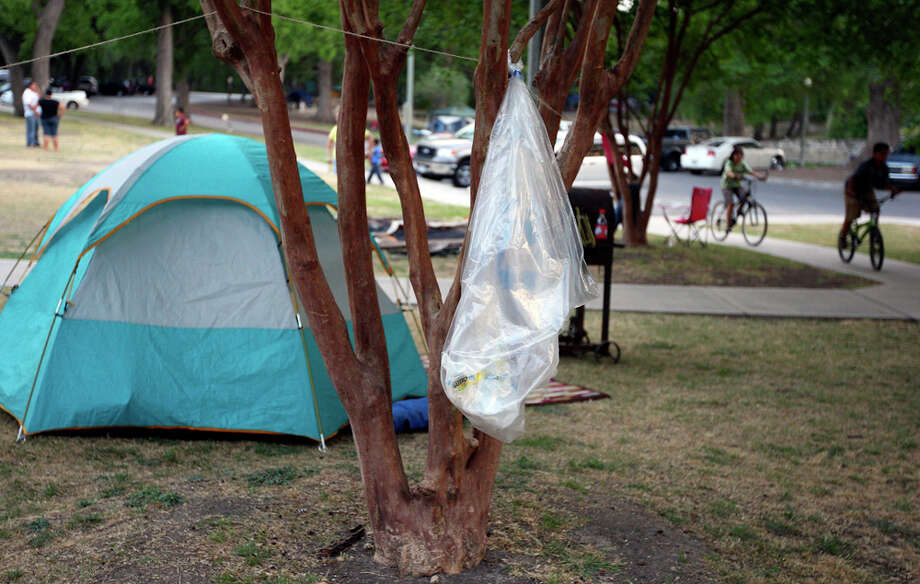 A recycling bag hangs from a tree on April 22 at Brackenridge Park as people camp for the Easter weekend.