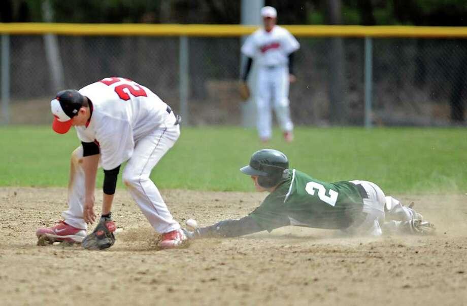 Shenendehowa's Nick Giunta is safe at second base as Mike Doynow misses throw during a baseball game against Guilderland in Guilderland, N.Y. Friday April 22, 2011. (Lori Van Buren / Times Union) Photo: Lori Van Buren