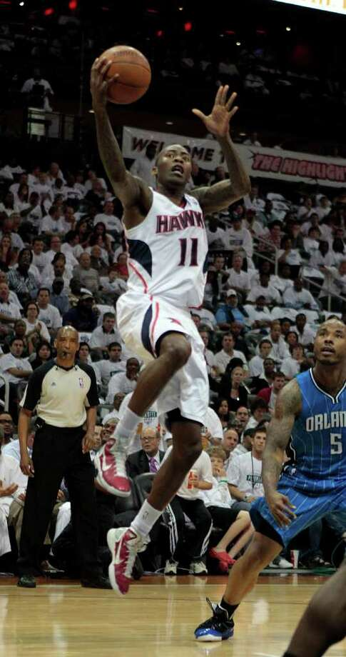 Atlanta Hawks guard Jamal Crawford (11) drives to the basket as Orlando Magic shooting guard Quentin Richardson (5) looks on in the second quarter half of Game 3 of a first-round playoff NBA basketball series in Atlanta, Friday, April 22, 2011. (AP Photo/John Bazemore) Photo: John Bazemore
