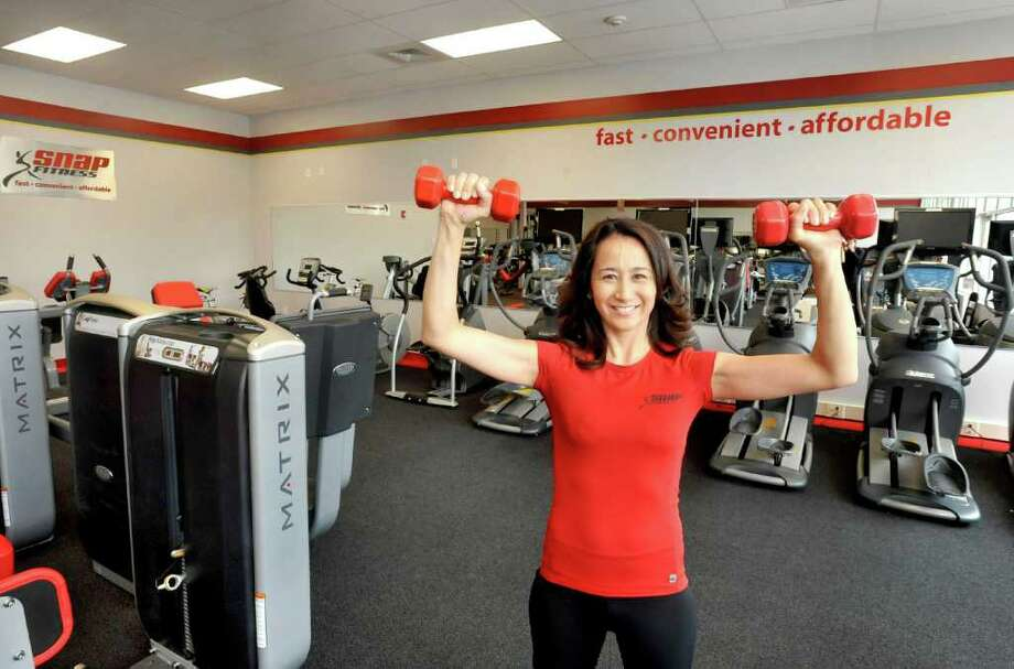 Lisa Rosado stands inside her new Snap Fitness workout center in Bethel, Friday, April 22, 2011. Photo: Michael Duffy / The News-Times