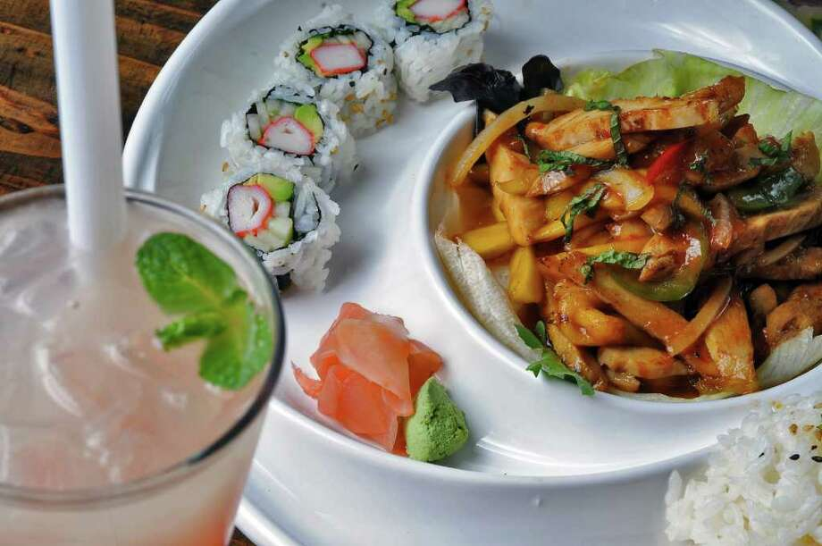 Mango Chicken Bento Box, and a Lychee Yogurt with Pop Boba, drink at left, at Ruby Asian Bistro on Madison Avenue on  Monday April 18, 2011 in Albany, NY. ( Philip Kamrass / Times Union ) Photo: Philip Kamrass