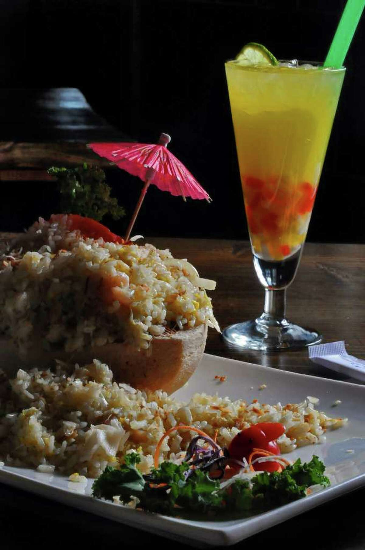 Seafood Coconut Fried Rice, and a Mango Yogurt with Mixed Fruit Jelly, drink at right, at Ruby Asian Bistro on Madison Avenue on Monday April 18, 2011 in Albany, NY. ( Philip Kamrass / Times Union )