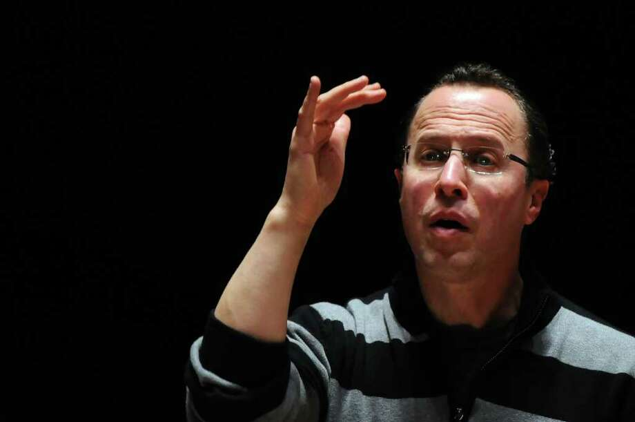 Albany Symphony Orchestra Conductor/Music Director David Alan Miller conducts a rehearsal at the Palace Theatre for the Albany Symphony Orchestra and Albany Pro Musica's performance of  Verdi's Requiem on Saturday January 22, in Albany, NY on Thursday January 20, 2011. ( Philip Kamrass / Times Union ) Photo: Philip Kamrass
