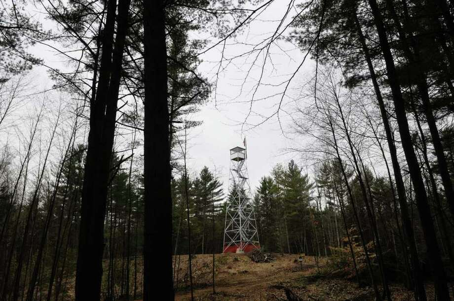 The Cornell Hill fire tower which once stood in Luther Forest has been moved onto land the town of Wilton owns and is part of the historic Camp Saratoga.  Photograph was taken on Tuesday afternoon, April 19, 2011.  (Paul Buckowski / Times Union) Photo: Paul Buckowski / 00012825A