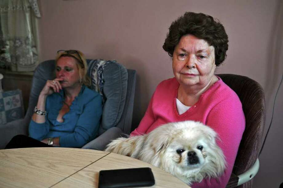 Joan Stowers may not receive the STAR exemption on her property taxes this year after missing the filing deadline for the exemption by less than two weeks. She and many other seniors in the same situation may have to pay substantially more taxes as a result. She holds her dog Mickey,  while sitting in her home with her daughter Lyn Malinowski, on  Tuesday April 19, 2011 in Albany, NY. ( Philip Kamrass / Times Union ) Photo: Philip Kamrass