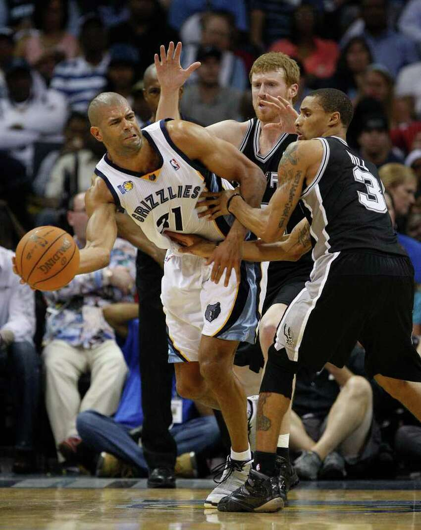 SPURS -- Memphis Grizzlies Shane Battier passes under pressure from San Antonio Spurs Matt Bonner and George Hill during the second half in the third game of the Western Conference Quarter First Round at FedExForum in Memphis, TN, April 23, 2011. The Grizzlies won 91-88 and go up 2-1 in the series. JERRY LARA/glara@express-news.net