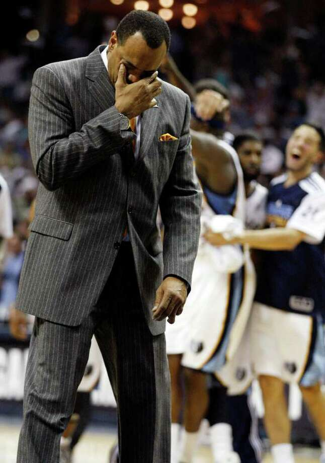 SPURS -- Memphis Grizzlies Head Coach Lionel Hollins reacts as players celebrate a last second three pointer by Zach Randolph that led to their victory over the San Antonio Spurs in the third game of the Western Conference Quarter First Round at FedExForum in Memphis, TN, April 23, 2011. The Grizzlies won 91-88 and are ahead in the series, 2-1. JERRY LARA/glara@express-news.net / SAN ANTONIO EXPRESS-NEWS (NFS)