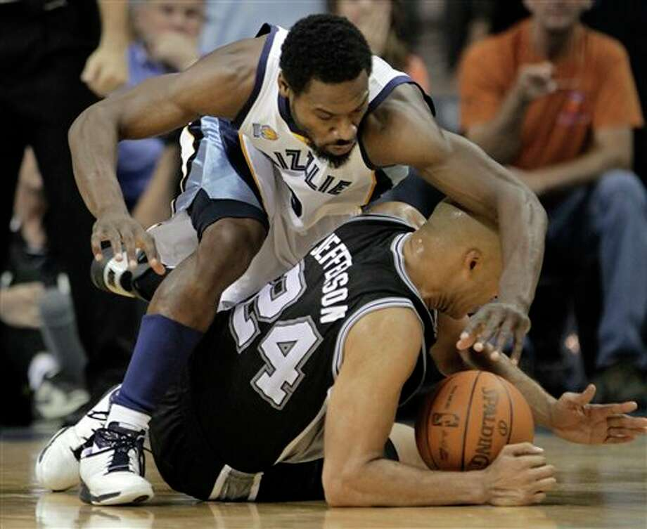 Grizzlies guard Tony Allen (top) fights for a loose ball with Spurs forward Richard Jefferson during Saturday's Game 3 in Memphis. Lance Murphey/Associated Press