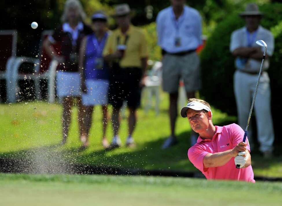 Luke Donald, of England, hits out of the bunker on eighth green during the third round of The Heritage golf tournament in Hilton Head Island, S.C., Saturday, April 23, 2011. (AP Photo/Stephen Morton)