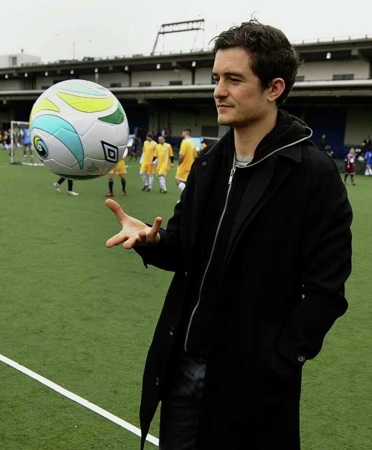 English actor Orlando Bloom plays with a soccer ball at the NYFEST, the inaugural Edition of NY's Film & Entertainment Soccer Tournament at the Tribeca Film Festival at Hudson River Park's Pier 40 in New York on Saturday, April 23, 2011. The event was for professionals and celebrities from the film, music, sports and entertainment worlds along with youth from all around New York for a fun day inspired by soccer and education. Photo: AFP/Getty Images