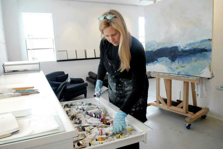 "Artist Susan Cutler Tremaine works in her studio in Norwalk, Conn. on Thursday April 14, 2011 preparing for the Wilson Avenue Loft Artists annual Spring sale and exhibit  "" FRESH "" on Saturday April 30 and Sunday May 1. Photo: Dru Nadler / Stamford Advocate Freelance"
