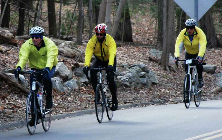A foursome of elder gentlemen - three of four whom are Westport residents - plan to bike 100 miles around Lake Tahoe in early June. The group got into outdoor training last month after having kept active over the winter on stationary bicycles. Pictured, from left to right, are Don Weber, coach Julian Jarreau and Ron Corwin, who, it just so happens, is the chairman of the Westport Planning & Zoning Commission. Photo: Contributed Photo / Westport News