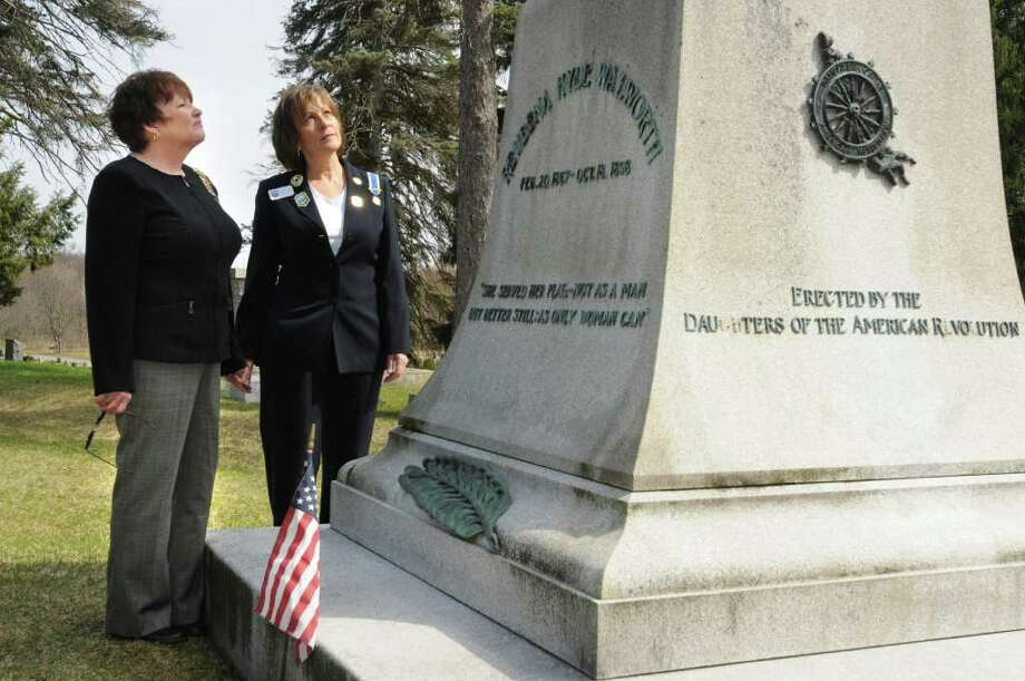 From left, Corinne Scirocco, Saratoga chapter region, and Lisa Doan, Saratoga monument city chairman, look at the monument honoring Reubena Hyde Walworth at Greenridge Cemetery in Saratoga Springs, N.Y. Friday April 22, 2011. (Lori Van Buren / Times Union) Photo: Lori Van Buren