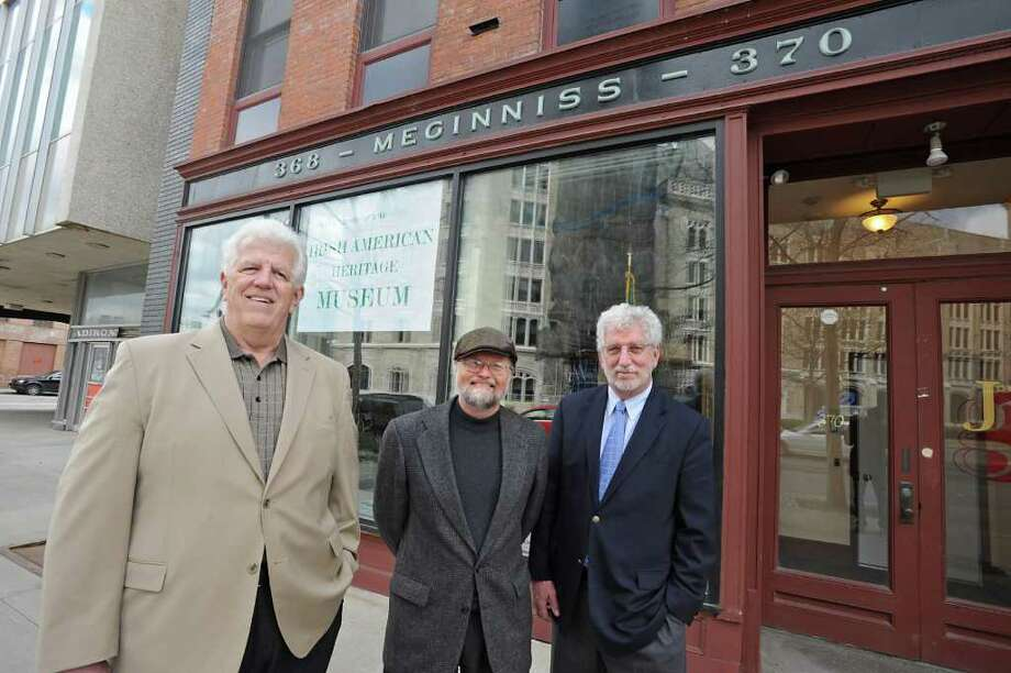 From left, Museum Trustees Jack Mulvey, Peter O'Connell, Ed Collins and Peter O'Connell stand in front of the future home of the Irish American Heritage Museum on Broadway in Albany, N.Y. Thursday April 21, 2011. This is the former Meginnis Electrical building.  (Lori Van Buren / Times Union) Photo: Lori Van Buren