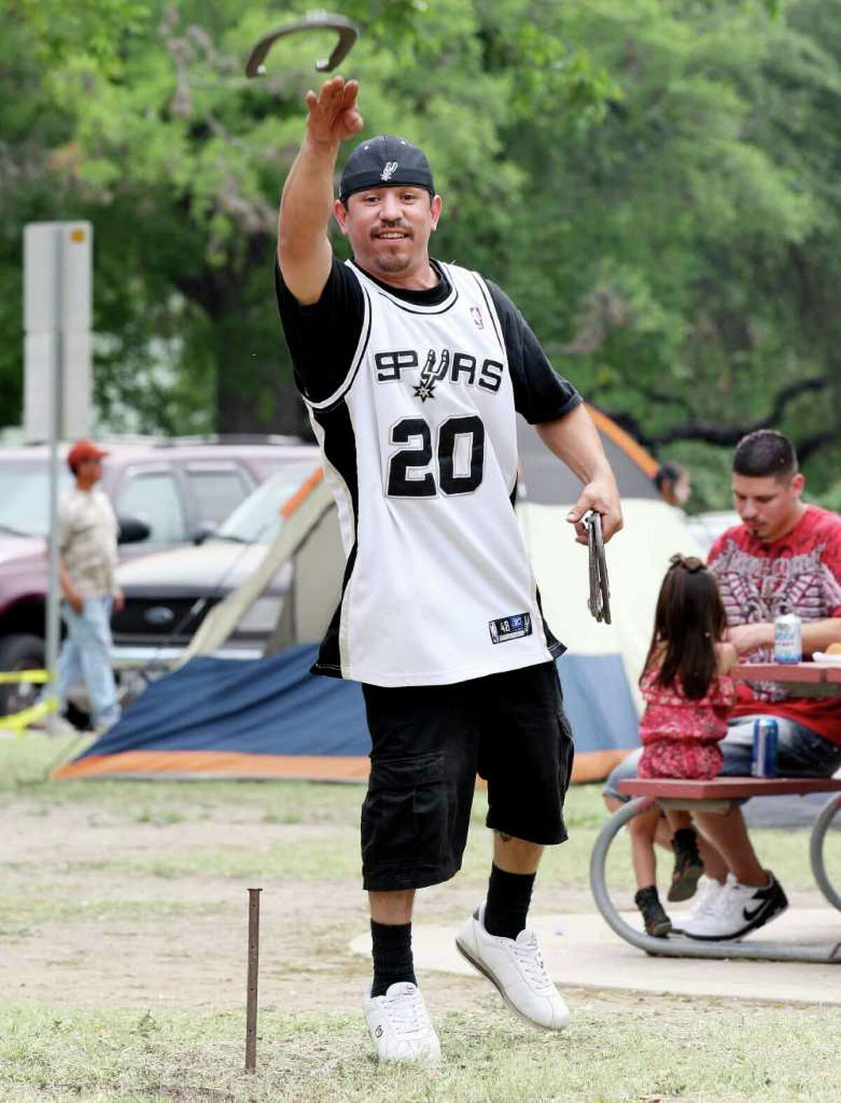 Nathan Ortiz plays horseshoes Sunday April 24, 2011 at Brackenridge Park while spending Easter with his family. (PHOTO BY EDWARD A. ORNELAS/eaornelas@express-news.net)