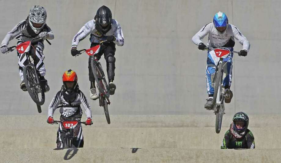 AUCKLAND, NEW ZEALAND - APRIL 23: (L-R) Daniel Bowers-Wilson of Christchurch, James Nattrass of Papakura and Cole McOnie of Camrbridge clear a jump in the Mens 13-14 Cruiser class during the New Zealand National BMX Championships held at the North Harbour BMX track on April 23, 2011 in Auckland, New Zealand.  (Photo by Phil Walter/Getty Images) *** Local Caption *** Daniel Bower-Wilson;James Nattrass;Cole McOnie; Photo: Getty Images