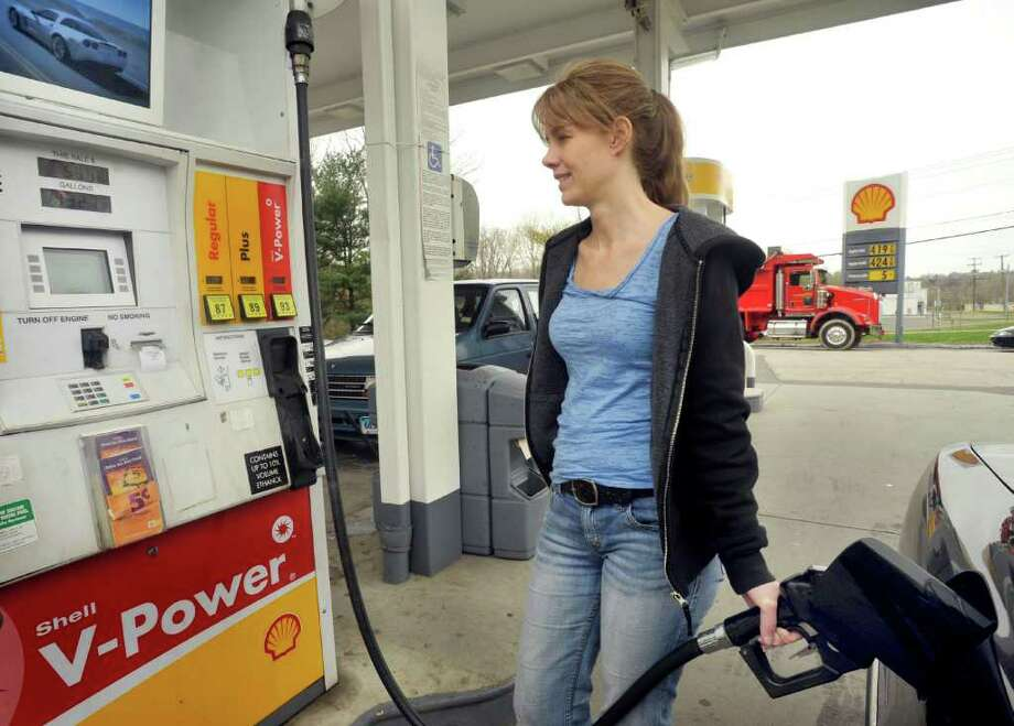 Stacey Terezakis, of Bethel, fills up at J&R Shell on Route 6 in Danbury, Monday, April 25, 2011. This is one of the Shell stations participating in a Stop&Shop promotion that discounts gas 10 cents a gallon. The present price is $4.19.9. Photo: Michael Duffy / The News-Times