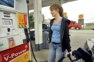 Stacey Terezakis, of Bethel, fills up at J&R Shell on Route 6 in Danbury, Monday, April 25, 2011. This is one of the Shell stations participating in a Stop&Shop promotion that discounts gas 10 cents a gallon. The present price is $4.19.9.