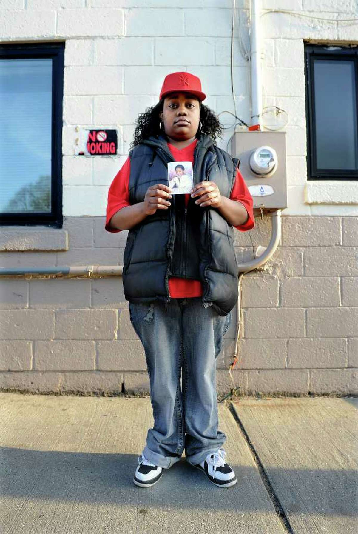 Tanya McDowell stands outside the Norwalk Emergency Shelter with a photo of her son, A.J. Paches, on Wednesday, April 20, 2011. McDowell, who is homeless and lives in her van, was arrested after enrolling her son in the Norwalk City School District.