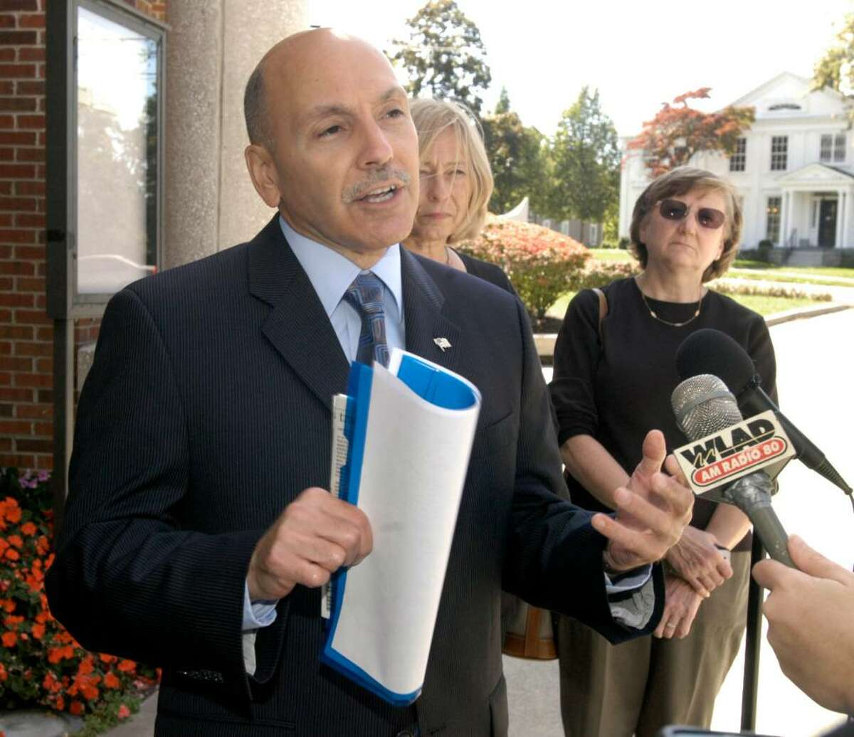 Gary Goncalves, Democratic candidate for Mayor in Danbury, left holds a press conference outside of City Hall Friday, Sept. 25, 2009. With him are Barbara Carey, right, Democratic candidate for the Common Council in the 3rd Ward and Eileen Coladarci, candidate for City Clerk.