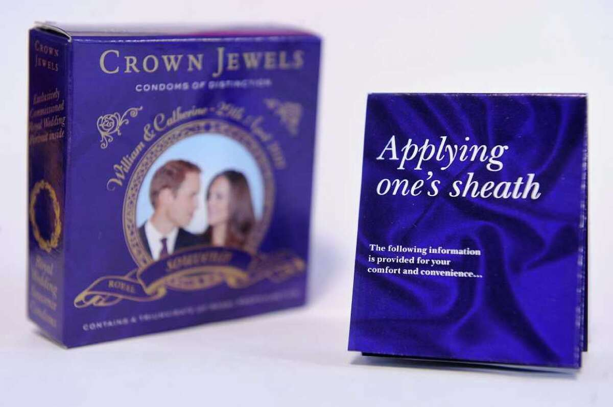 """A souvenir box of condoms for the royal wedding of Britain's Prince William and Kate Middleton is pictured in in central London, on Feb. 8, 2011. While Britain has a public holiday to celebrate Prince William's wedding, one company is taking the party one step further with souvenir condoms that urge lovers to """"lie back and think of England"""". Crown Jewels Condoms of Distinction is producing special celebration packs that bear the slogan: """"Like a royal wedding, intercourse with a loved one is an unforgettable occasion"""". AFP PHOTO/Ben Stansall"""