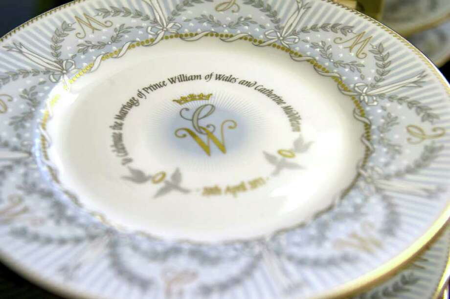 One of the commemorative plates waits in the production line to be hand finished as part of a limited edition Official Royal Wedding Commemorative China collection.  Official pottery commemorating the royal wedding between Britain's HRH Prince William and Catherine Middleton, is being hand finished at a factory in Stoke-on-Trent, England, Wednesday March 23, 2011.  The official commemorative fine china, named The Royal Collection,  including various designs of cups, pill boxes and plates is being completed for the royal wedding on April 29, 2011.(AP Photo) Photo: Paul Grover, POOL / San Antonio Express-News