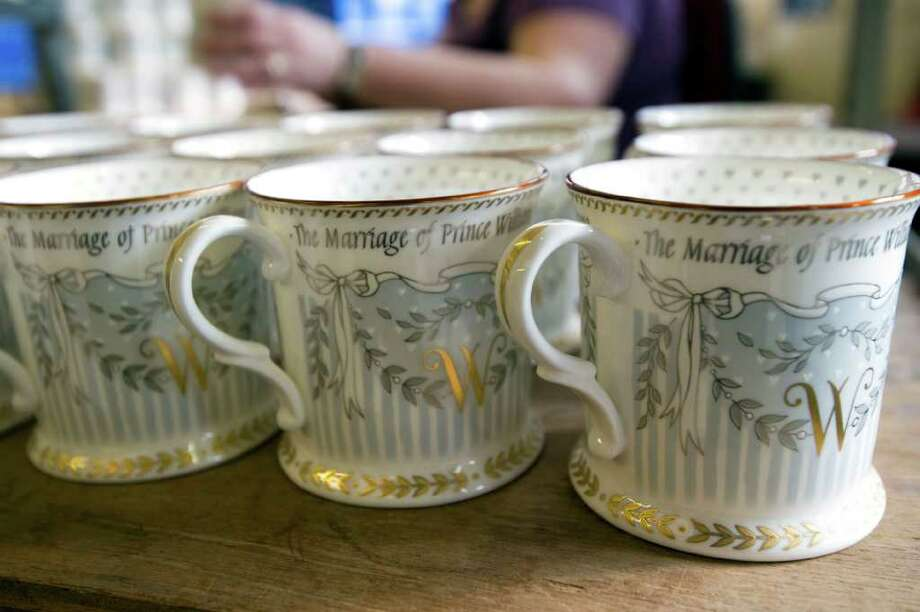 A limited edition of commemorative cups is being finished, as part of a limited edition of Official Royal Wedding Commemorative China collection.  Photo: Paul Grover, POOL / San Antonio Express-News