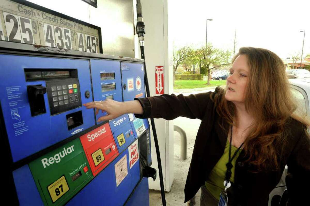 Sheila Barry, of Katonah, N.Y., fuels her car at Danbury Fair Mobil on Backus Avenue. Regular gas is $4.25.9 there, Monday, April 25, 2011.
