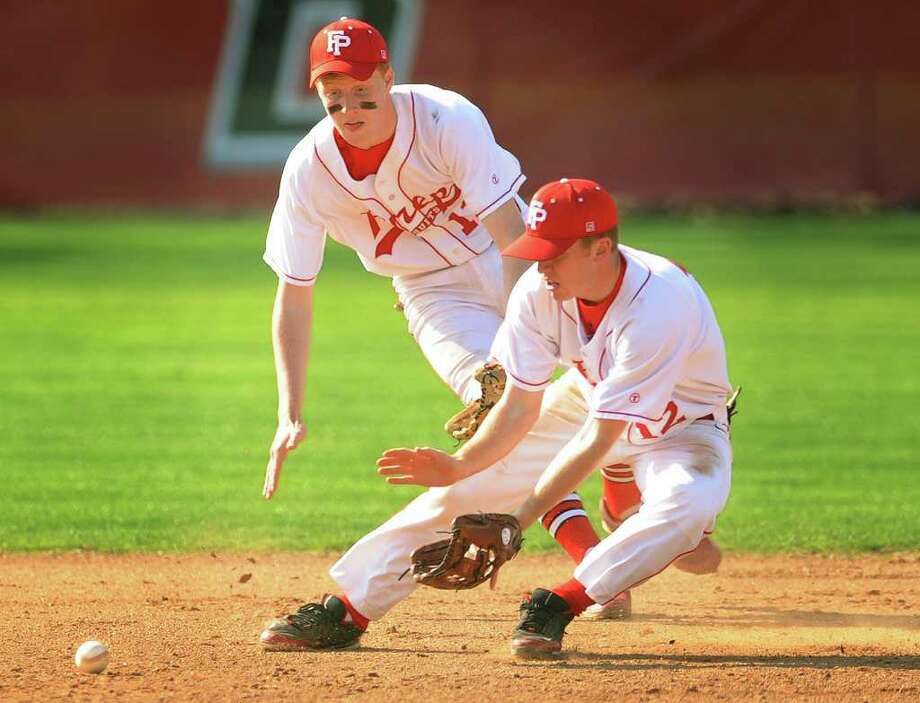 Fairfield Prep shortstop Alex Heiman, left and second baseman Matt D'ambrisi converge on a ground ball in the third inning of their matchup with West Haven at Fairfield University's Alumni Field on Monday, April 25, 2011. Photo: Brian A. Pounds / Connecticut Post