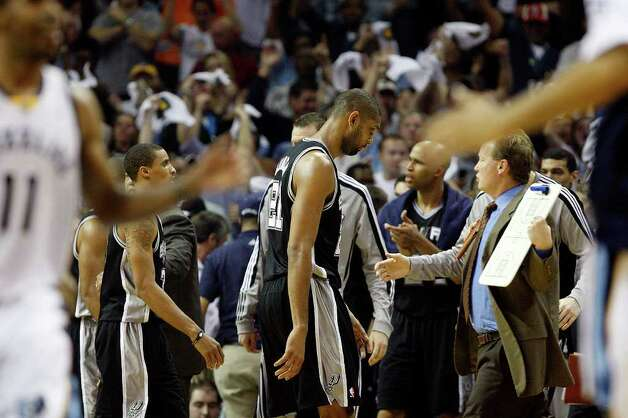 Spurs Tim Ducan walks off the court as Memphis Grizzlies Mike Conley, left, celebrates a shot with teammates during the second half of game four of the Western Conference First Round at FedExForum in Memphis, TN, Monday, April 25, 2011. The Grizzlies won 104-86 and lead the series, 3-1. JERRY LARA/glara@express-news.net / SAN ANTONIO EXPRESS-NEWS (NFS)