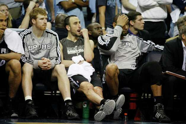 Spurs Matt Bonner, Manu Ginobili and Tim Duncan sit out the last part of the fourth quarter as they lose to the Memphis Grizzlies, 104-86 in game four of the Western Conference First Round at FedExForum in Memphis, TN, Monday, April 25, 2011. The Grizzlies lead the series, 3-1. JERRY LARA/glara@express-news.net / SAN ANTONIO EXPRESS-NEWS (NFS)