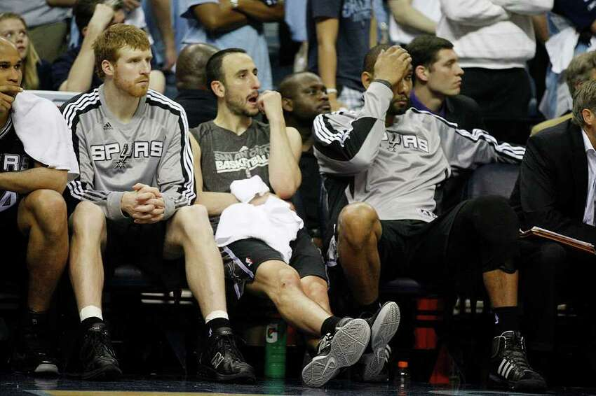 Spurs Matt Bonner, Manu Ginobili and Tim Duncan sit out the last part of the fourth quarter as they lose to the Memphis Grizzlies, 104-86 in game four of the Western Conference First Round at FedExForum in Memphis, TN, Monday, April 25, 2011. The Grizzlies lead the series, 3-1. JERRY LARA/glara@express-news.net