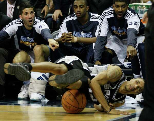 Spurs George Hill tries to keep the ball in bound as Memphis Grizzlies from left, Greivis Vasquez, Darrell Arthur and O.J. Mayo point out the play which was rulled out of bound during the second half of game four of the Western Conference First Round at FedExForum in Memphis, TN, Monday, April 25, 2011. The Grizzlies won 104-86 and lead the series, 3-1. JERRY LARA/glara@express-news.net / SAN ANTONIO EXPRESS-NEWS (NFS)