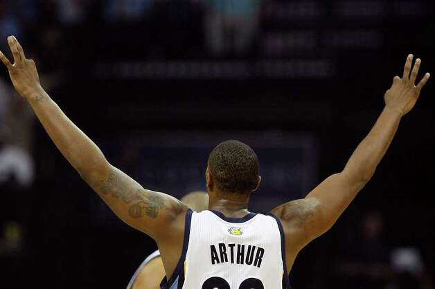 Memphis Grizzlies Darrell Arthur celebrates a three-pointer against the San Antonio Spurs during the first half of game four of the Western Conference First Round at FedExForum in Memphis, TN, Monday, April 25, 2011. JERRY LARA/glara@express-news.net / SAN ANTONIO EXPRESS-NEWS (NFS)