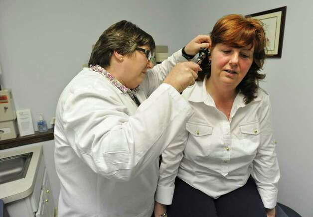 Nurse practitioner Jane Nugent examines patient Darlene Prince of Burnt Hills at Nugent's office in Scotia, N.Y., on Monday, April 4, 2011. (Lori Van Buren / Times Union) Photo: Lori Van Buren