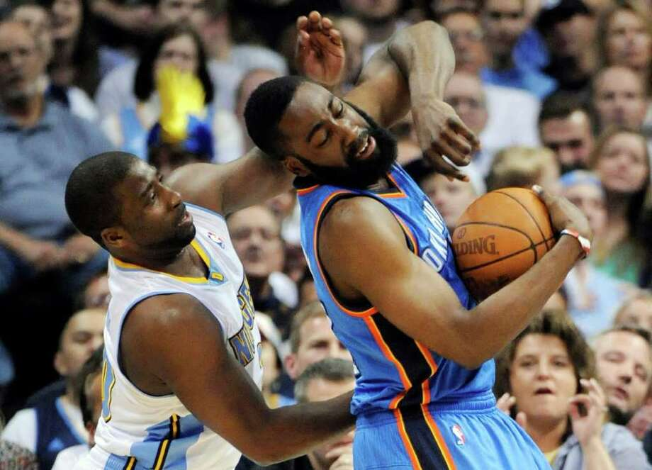 Denver Nuggets guard Raymond Felton (20) knocks the ball from the hands of Oklahoma City Thunder guard James Harden (13) during the first half in game 4 of a first-round NBA basketball playoff series Monday, April 25, 2011, in Denver. Photo: Jack Dempsey