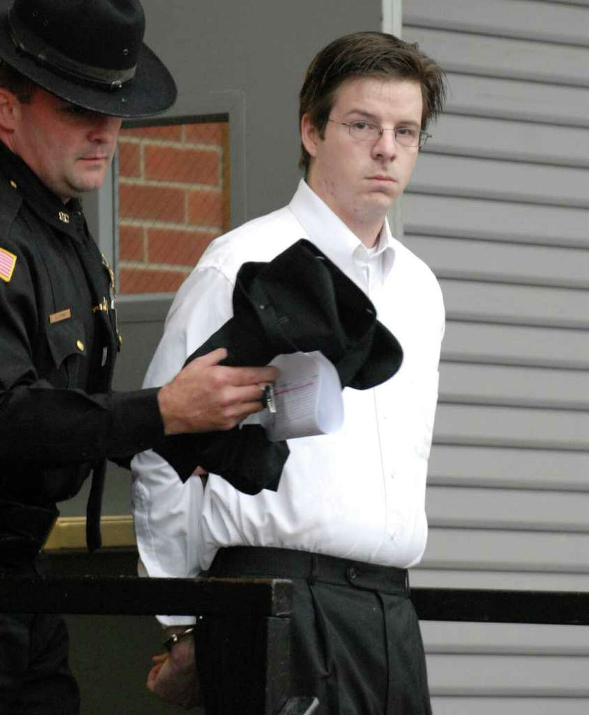 TIMES UNION STAFF PHOTO WILL WALDRON -- Clifton Park elementary school teacher Christopher Culver is escorted out of the Saratoga County Courthouse where he admitted in court to molesting eight of his first-grade students, and plead guilty to all charges against him, Monday moring in Ballston Spa November 26, 2007.