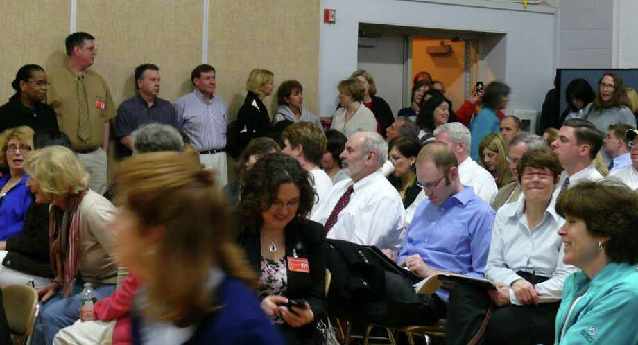 A standing-room-only crowd turned out Monday night to hear deeper cuts proposed by the Representative Town Meeting's GOP majority in the 2011-12 budget. Photo: Genevieve Reilly / Fairfield Citizen