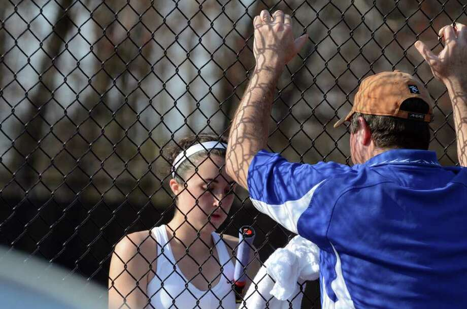 Fairfield Ludlowe's Alyssa McAndrew gets a pep talk from the sidelines during the girls number one singles tennis match at Warde on Monday, Apr. 25, 2011. Photo: Amy Mortensen / Connecticut Post Freelance