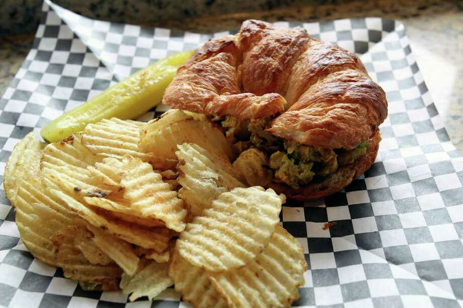 A curried chicken salad sandwich at Tazas Coffee includes raisins and chopped walnuts. Photo: TOM REEL, SAN ANTONIO EXPRESS-NEWS / © 2011 San Antonio Express-News