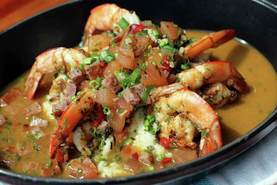 Chef Steve McHugh creats Jumbo Louisiana Shrimp with Andouille and White Corn Grits at Luke. Photo: Jennifer Whitney, Special To The Express-News / special to the Express-News
