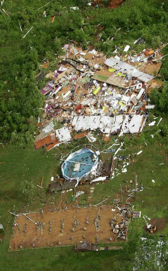 A building is seen destroyed in Vilonia, Ark., on Tuesday after a tornado struck the area late Monday. Photo: AP